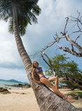 Beautiful young woman posing on tropical beach during summer day Royalty Free Stock Photos