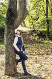 Beautiful young woman posing under the beech tree in autumn natu Stock Photography
