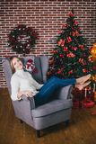 Beautiful young woman posing under Christmas tree stock images