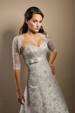 Beautiful young woman posing in a wedding dress. The beautiful young woman posing in a wedding dress Royalty Free Stock Images