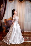 The beautiful young woman posing in a wedding dress Royalty Free Stock Photo