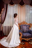 The beautiful young woman posing in a wedding dress Royalty Free Stock Photos