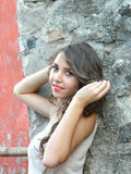 Beautiful young woman,posing in white top and long brown skirt. Royalty Free Stock Photos