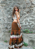 Beautiful young woman,posing in white top and long brown skirt. Stock Photography