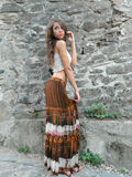 Beautiful young woman,posing in white top and long brown skirt. Beautiful young woman,posing in city of Sighisoara, Romania, expressive, with white top and long Stock Photo