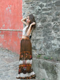 Beautiful young woman,posing in white top and long brown skirt. Beautiful young woman,posing in city of Sighisoara, Romania, expressive, with white top and long Royalty Free Stock Image