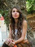 Beautiful young woman,posing in white top and long brown skirt. Royalty Free Stock Photography