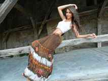 Beautiful young woman,posing in white top and long brown skirt,. Beautiful young woman,posing in city of Sighisoara, Romania, expressive, with white top and long Stock Photo