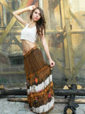 Beautiful young woman,posing in white top and long brown skirt,w. Beautiful young woman,posing in city of Sighisoara, Romania, expressive, with white top and Royalty Free Stock Image