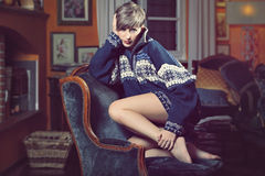 Beautiful young woman posing with wool sweater Royalty Free Stock Images