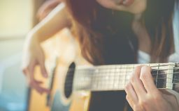 Beautiful young women are practicing to use the finger to play t stock images