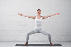 Beautiful young woman practicing yoga poses royalty free stock image