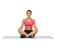 Beautiful young woman practising yoga Stock Photo