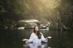 Beautiful young woman praying Royalty Free Stock Image