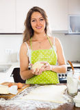 Beautiful young woman preparing cakes Royalty Free Stock Image