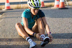 Beautiful young woman preparing for cycling on road. Royalty Free Stock Photo