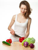 Beautiful young woman preparing salad Royalty Free Stock Photo