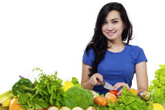 Beautiful young woman preparing vegetables Royalty Free Stock Images