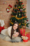 Beautiful young woman with present boxes and cookies for Christm Stock Photos
