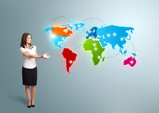 Young woman presenting colorful world map Royalty Free Stock Image