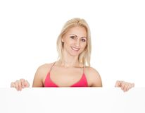 Beautiful young woman presenting an empty board Stock Images