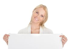 Beautiful young woman presenting empty board Stock Photography