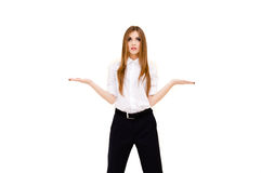 Beautiful young woman presenting something imaginary with her hands on white background Royalty Free Stock Photo