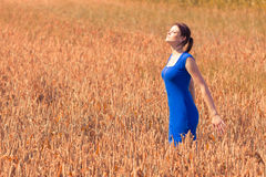 Beautiful young woman with pretty dress in nature Royalty Free Stock Image