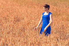 Beautiful young woman with pretty dress in nature. The blue of the dress is the only blue in the picture - perfect for coloration Stock Photography