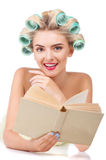 Beautiful young woman with pretty smile is reading Stock Photos