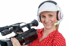 Beautiful young woman with a professional video camera and headp. A beautiful young woman with a professional video camera and headphone Stock Photography