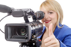 Beautiful young woman with a professional video camera and headp Stock Images