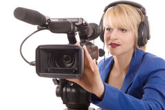 Beautiful young woman with a professional video camera and headp Stock Photos