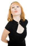 Beautiful young woman puckering up for a kiss stock photos