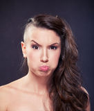 Woman Puffs Cheeks. Beautiful Young Woman Puffs Cheeks Royalty Free Stock Images