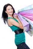 Beautiful young woman with purchases Royalty Free Stock Photos