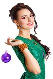 Beautiful young woman with a purple Christmas bauble Stock Photo