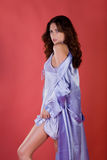 Beautiful young woman in purple housecoat Royalty Free Stock Photo