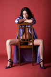 Beautiful young woman in purple housecoat Royalty Free Stock Images