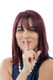 Beautiful young woman put a finger to her lips Royalty Free Stock Photography