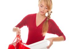 Beautiful young woman puts a purchase Stock Images