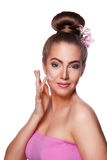 Beautiful young woman putting face cream on Royalty Free Stock Photos