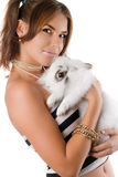 Beautiful young woman with rabbit Royalty Free Stock Image