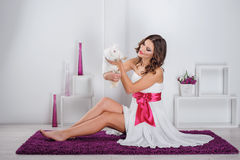 Beautiful young woman with rabbit Stock Photography