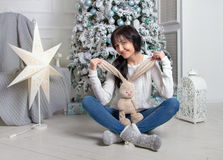 Beautiful young woman with rabbit Stock Images