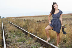 Beautiful young woman on the railroad Royalty Free Stock Photos