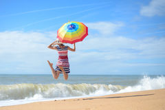 Beautiful young woman with rainbow umbrella Royalty Free Stock Photography