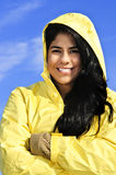 Beautiful young woman in raincoat Stock Images