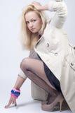 Beautiful young woman in raincoat Stock Image