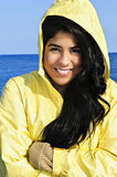 Beautiful young woman in raincoat royalty free stock image